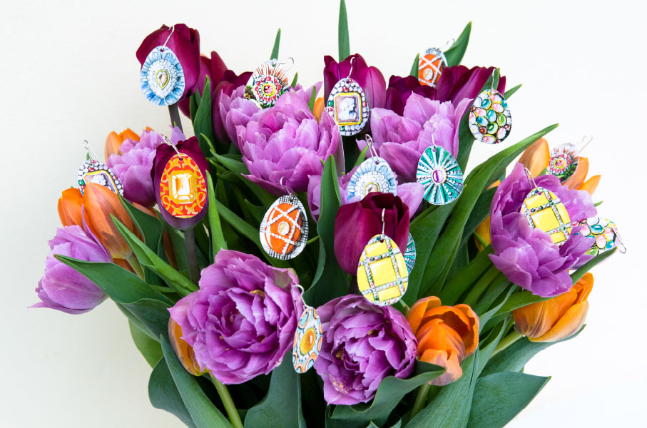 bodyfurnitures easter egg paper earrings on tulip flowers bouquet