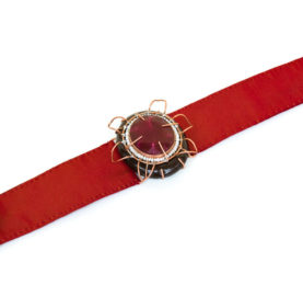 Italian contemporary jewelry: Bracelet Aes, 2017, made of papier-mâché, root ruby, copper, red silk. Handmade baroque jewelry by italian artist Gian Luca Bartellone, Bolzano.