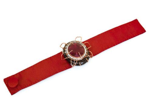 Italian contemporary jewelry: Bracelet Aes, 2017, made of papier-mâché, root ruby, copper, red silk. Handmade baroque jewelry by italian artist Gian Luca Bartellone, Bolzano.