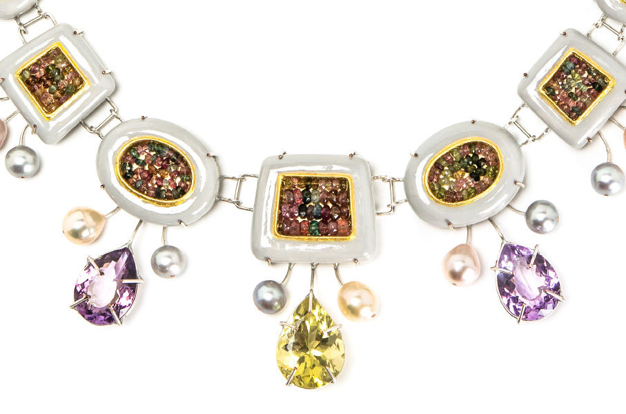 Rich details of italian contemporary jewelry. Closeup colorful materials: papier-mâché, silver-plated copper, citrine, rose amethysts, tourmalines, pearls, paper, gold leaf 22kt. Jeweller Bartellone, Bodyfurnitures, Bolzano.